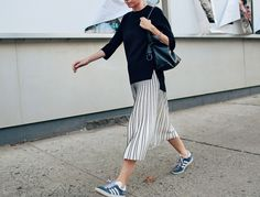 The key to balancing the drama of a maxi is to pair it with something simple and sporty. What's nice about this look is that it works in a variety of situations—slightly more dressed down …