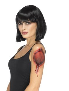 Tatuointikuvat; olkapäähaava. Täydennä keinoverellä.