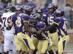 Members of the Catamount defense celebrating the fumble recovery and touchdown at the start of the game against Samford.