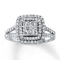 This engagement ring is a beautiful declaration of your love. Crafted of 14K white gold and decorated in round diamonds totaling 1 carat in weight, sparkling round diamonds form a square at the center, framed in two rows of round diamonds. Additional lines of diamonds adorn the band. Diamond Total Carat Weight may range from .95 - 1.11 carats.