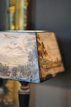 Pinner stated that they have done this before with success - cover a square lampshade with a classic wallpaper - beautiful when illuminated