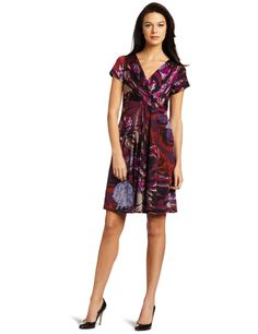 This heather printed jersey dress has a short sleeve with overlapping neck line and cascade down left waist..    Get your Tiana B Women's Heather Jersey Dress at http://tiny.cc/q2gzcw