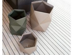 Origami Leather Bins - with proper treatment, looks like another material other than leather - Sabrina