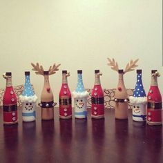 Painted wine bottles I made last year perfect Christmas gifts or holiday decor