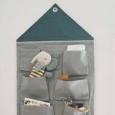 Keep clutter at bay with ferm LIVING's handy wall tidy. Crafted from durable cotton canvas in tonal blues, this house-shaped design features nine handy pockets, perfect for storing smaller items. The practical eyelet ensure easy hanging, wherever you decide to use it. #fermlivingkids #designforkids #danishdesign #housewall #storage #caughtinthemoment #regram @scandikids