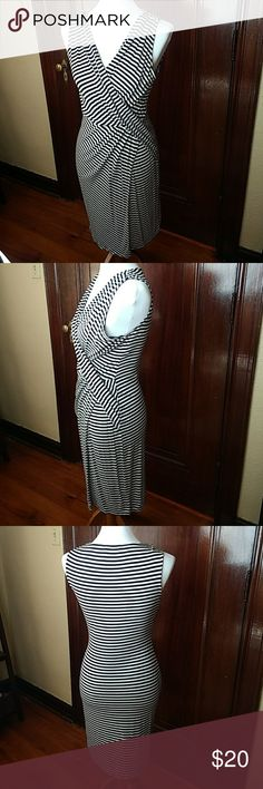 """Calvin Klein Faux wrap dress Black and white striped faux wrap dress. Super flattering. Fits my 4/6 dress form like a glove. 39"""" in length from shoulder to hem, 17"""" across bust laying flat. Has stretch. Calvin Klein Dresses"""