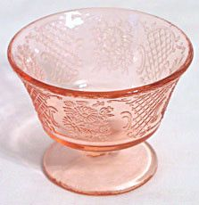 These are Depression Glass sherbet dishes in the Normandie or Bouquet & Lattice pattern made by Federal. The color is pink and they are in good condition with no chips or cracks.
