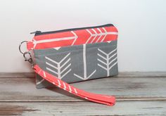 Hey, I found this really awesome Etsy listing at https://www.etsy.com/listing/203481451/coral-gray-wristlet-coral-gray-arrows