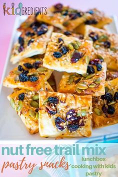 These nut free trail mix pastry squares are perfect as an afternoon pick me up or as a recess snack.  Make them in only 20 minutes! #kidgredients #kidsfood #snacks #nutfree #lunchbox #easyrecipe #crunchy #trailmix via @kidgredients