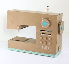 DIY Cardboard Box Play Sewing Machine is part of Cardboard crafts For Adults Make an adorable play sewing machine from an old cardboard box with this great tutorial from littleredwindow com! Diy For Kids, Crafts For Kids, Cardboard Play, Cardboard Box Crafts, Carton Diy, Diy Karton, Fun Crafts, Paper Crafts, Fabric Crafts