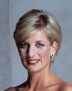 Princess Diana - Sapphire and Diamond Cluster Earrings.  The single oval sapphire is surrounded by 10 diamonds.
