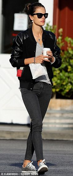 Cool mother-of-two: The model looked hip in her black bomber jacket and Converse sneakers