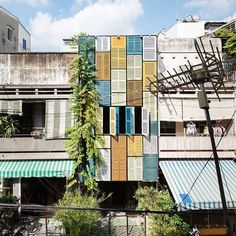 the colorful façade of vegan house by block architects where traditional vietnamese shutter windows were re-used to create the changing exterior.⠀ ⠀ ⠀ ⠀ see more #architecture from #vietnam on #designboom! #facade