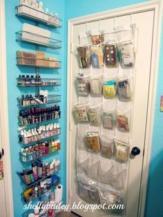 Shelly Bailey uses the elfa Door & Wall Rack to hold paints, sprays, mists and other craft gear! Neat!