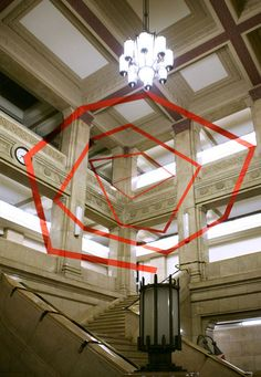 Felice Varini sees the world differently than most. Using a technique called anamorphosis, the Swiss artist has been busy over the last thirty years creating optical illusions that can only be seen in their intended entirety from a certain angle. Step one degree off your mark, and all you see is a collection of randomly …