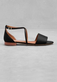 Laid-back and feminine sandals featuring a glossy satin upper.