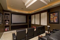 Carpet, Modern, Built-in bookshelves/cabinets. Like a dream come true. A home movie theater