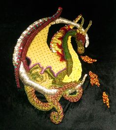 A 3D embroidery using beads, goldwork threads and silk worm cocoons. 2016
