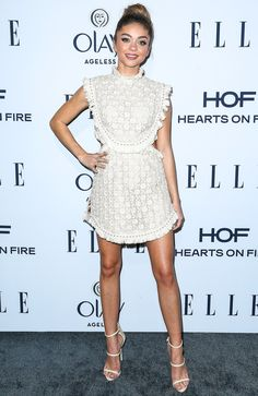 Sarah Hyland wears a fringey knit cream Zimmermann mini dress and matching three-strap Giuseppe Zanotti sandals, plus Anita Ko jewels, at Elle's Women in Television dinner.