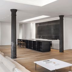 This minimal loft apartment for a New York-based photographer has areas for meeting clients, entertaining guests and escaping city bustle.
