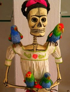 Frida Kahlo paper mache doll with parrots.