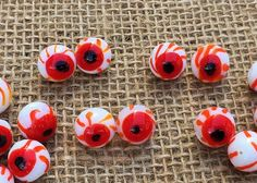 These beads have their eye on you! Make a pair of eyeball earrings to wear as Halloween jewelry with your Halloween costume or make some creepy Halloween wedding favors. Create Halloween table decor with blood shot eye beaded napkin rings. These beads measure 12mm and come in sets of 2 beads.  Their 1mm beading holes travel vertically - top to bottom of the eyeball.  Each one of these beads are handcrafted by assorted artists, so beads of the same likeness may vary slightly in appearance…