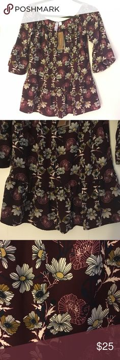 NWT Alya (Francesca's) 3/4 sleeved top Alya (Francesca's) 3/4 sleeved top. Maroon, white, black with subtle gold/yellow floral pattern. Adorable ruffles and bottom and sleeves. Great for fall. Alya Tops Blouses