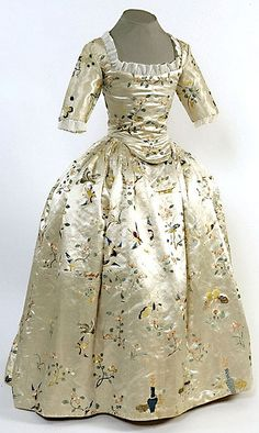 Girl's dress (back fastening gown), China for the Western Market, Great Britain (made), c. 1760. Ivory silk hand embroidered in coloured silks with floral motifs, birds, butterflies and baskets of fruits and flowers.