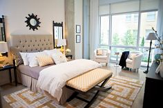 Suzie: Studio Ten 25 - Chic city bedroom with Rome Gold Greek Key Rug, taupe tufted headboard, ...