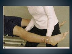 Modification 1  PROCEDURE  • The patient is sitting with the leg over the edge of  the examining table. The examiner sits fac...