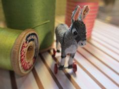 Dollhouse Miniature  Donkey on Wheels Toy via Etsy
