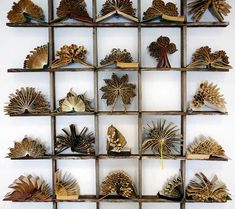 It seems like anything can be made out of old books nowadays, and artist Pam Langdon has transformed them into flowers. These paper sculptures have been meticulously folded, with the artist paying close attention to detail. The artist also treats her work like actual flowers and arranges them on shelves as though they are natural specimens. The only aspect of these sculptures that remind us they were once books is the yellowish tinge of each blossom.