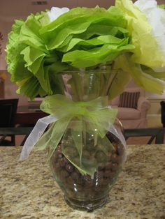 Malted milk balls fill a vase with paper napkin flowers.