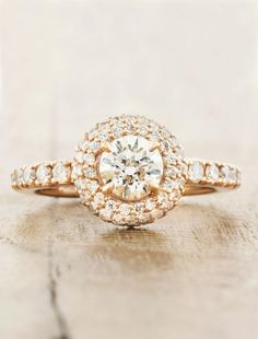 Our client asked for sparkle and boy, she sure does! Kelley, the 14k Rose Gold setting, is set with a brilliant round cut diamond at her heart.