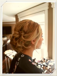 What a beautiful way to have your hair up and out of your face on your big day! This would go perfectly with a broach or a veil!
