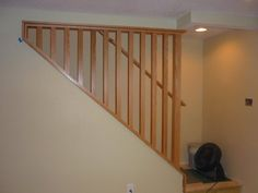 A removable stairway wall and railing makes moving furniture in and out much easier.
