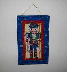 Nutcracker door hanging - Christmas skier winter decor - red green gold blue small quilted wall hanger - snow skiing - coworker hostess gift…