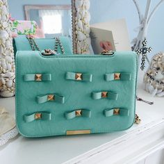"""Host PickSALETurqoise Blue Studded Purse Cross body purse can be worn with the shorter chain strap it longer looks great inside and out 9.5""""wide x 7"""" high x 3"""" Bags"""