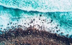 Download wallpapers coast, sea, waves, stone beach, top view, blue water