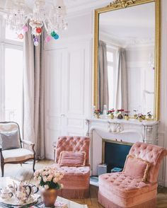 Like: velvet armchairs in front of the fireplace and the gilt mirror above it