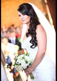 Long brown curly hair worked well with the gorgeous Sophia Tolli wedding dress