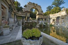 The Roman Ruins in Schönbrunn Palace Park with the river gods Danube and Enns. The Schönbrunn Palace Park is one of Vienna's most beloved recreational areas. Palace Garden, Roman Empire, Cathedral, Tours, Mansions, Architecture, Vienna Austria, House Styles, Marie Antoinette