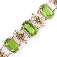 This early-twentieth century charmer presents a glowing trio of luscious lime-green oval peridots, bezel-set in delicate rope motif birders and interspersed with lovely floral motif filigree sections which gently graduate toward the clasp. Extra-sweet and lovely, circa 1900