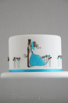 A cute cake for the top of a 3 tier wedding cake.