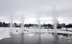 City of Ottawa workers blast ice with explosive on the Rideau River to prevent spring flooding.  (Dave Chan For The Globe and Mail)