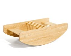 The Montessori school I went to as a child had a wooden rocking boat like this. Very fun, but also very expensive...