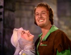 "Olivia de Havilland and Errol Flynn as Maid Marian and Robin Hood in ""The Adventures of Robin Hood"" (1938)"
