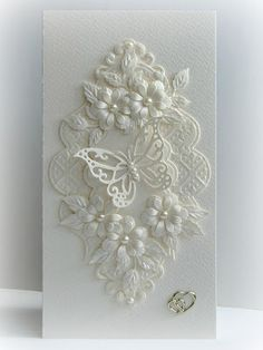 handmade wedding card from Paper Fever ,,, white on white ... layers of die cut flowers, flourishes and lacy frame ... gorgeous card!
