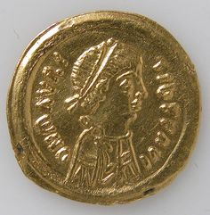 Tremissis of Mauricius Tiberius Date: ca. 582–602 Culture: Byzantine Medium: Gold Dimensions: Overall: 5/8 x 1/16 in. (1.6 x 0.1 cm)