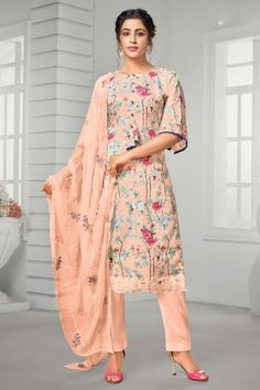 Cast a spell with this salmon peach cotton trouser suit which comprises an elegant ethnic look. This round neck and elbow sleeve clothing beautified with floral print work. Matched with cotton trouser pant in salmon peach color with salmon peach chiffon dupatta. This trouser suit can be customised up to maximum size 44 inches. #Cotton #Trousersuit #Malaysia #Andaazfashion